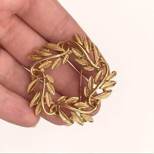 Antique gold tone brooch